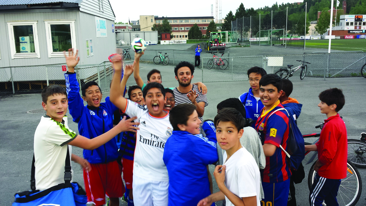 Copa90 presenter Eli Mengem is mobbed by excited kids in Norway. Photo by Lawrence Tallis for Copa90