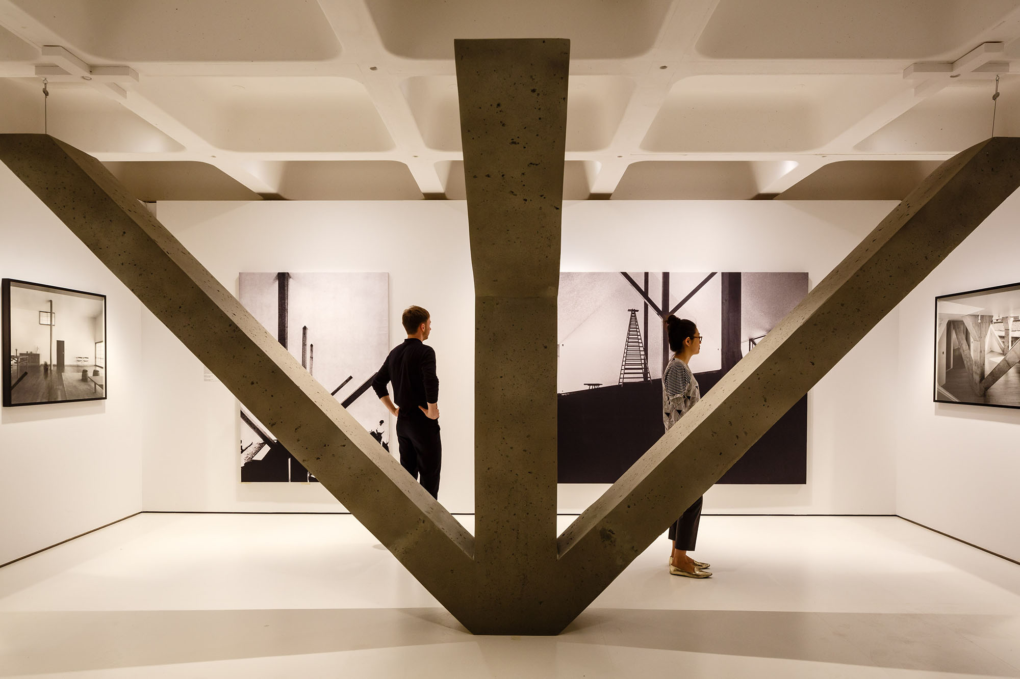 The exhibition includes a 1:1 reconstruction of the structural beams used by architect Kazuo Shinohara's House in Uehara (1976), a house created for photographer Kiyoji Ohtsuji. The main portion of the house is a concrete block with a lightweight steel structure on top