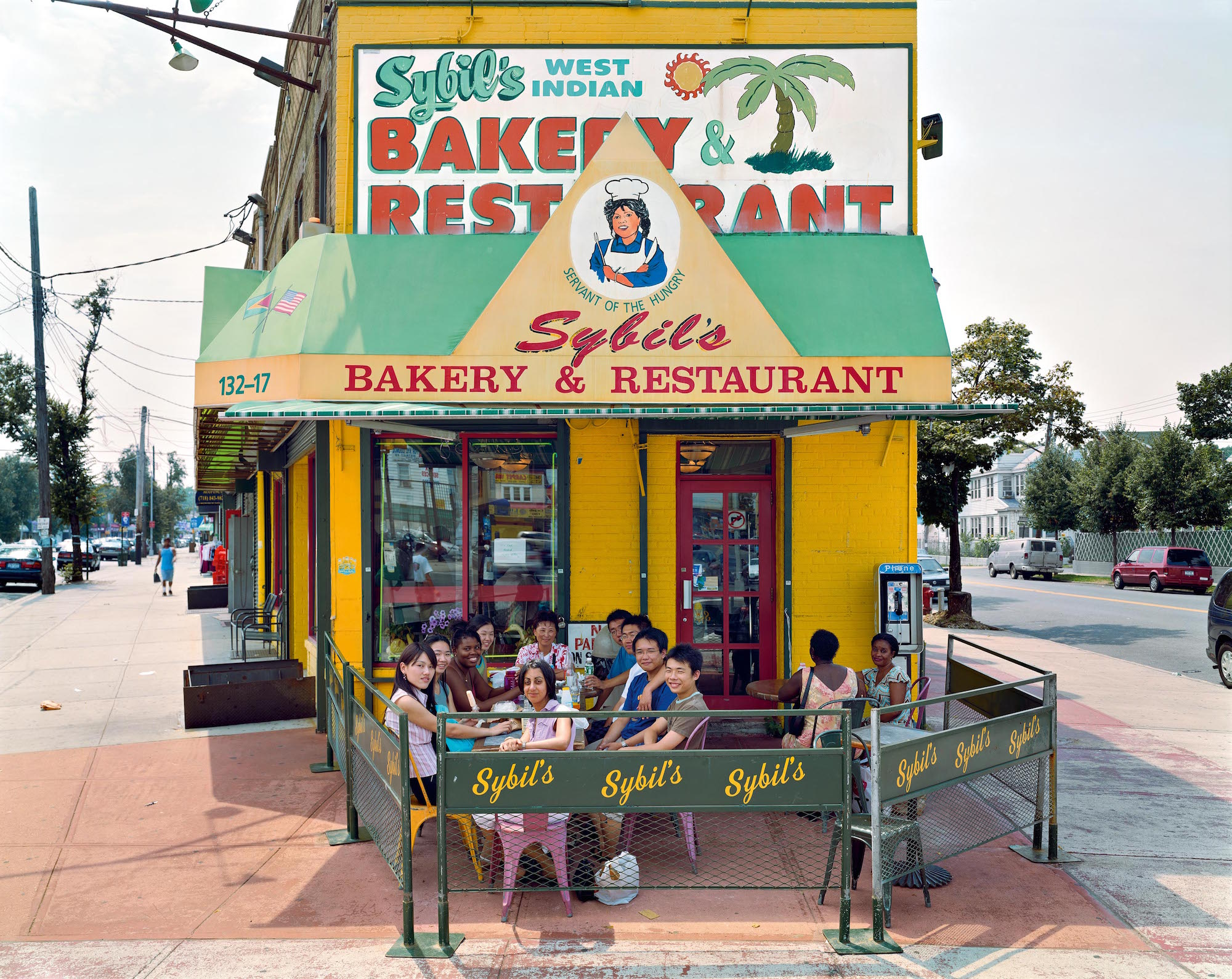 Sybil's West Indian Bakery and Restaurant – 132‐17 Liberty Avenue, Queens, July 2003, by Joel Sternfeld