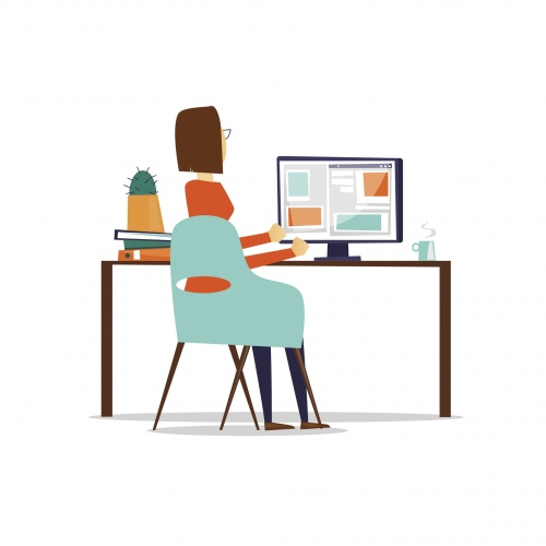 Woman sitting at the table and working on the computer