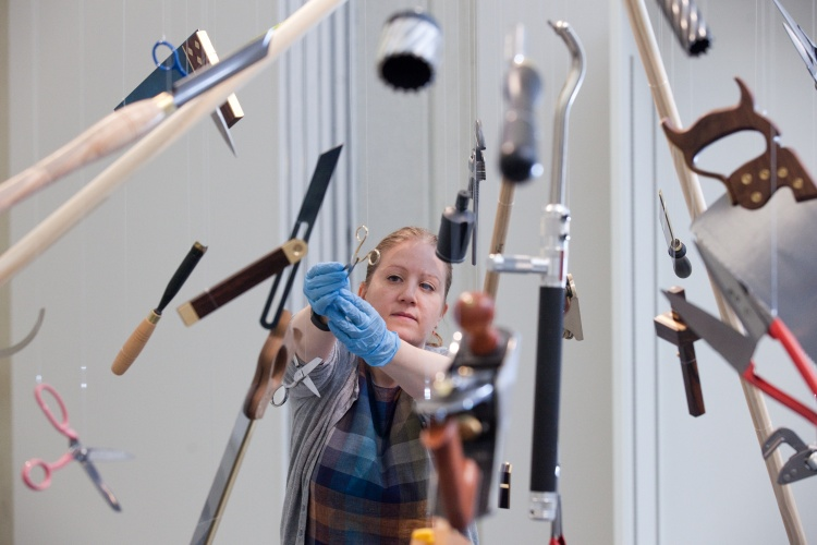 Exhibition curator Louisa Briggs with the Made in Sheffield tool explosion. Photo © Andy Brown