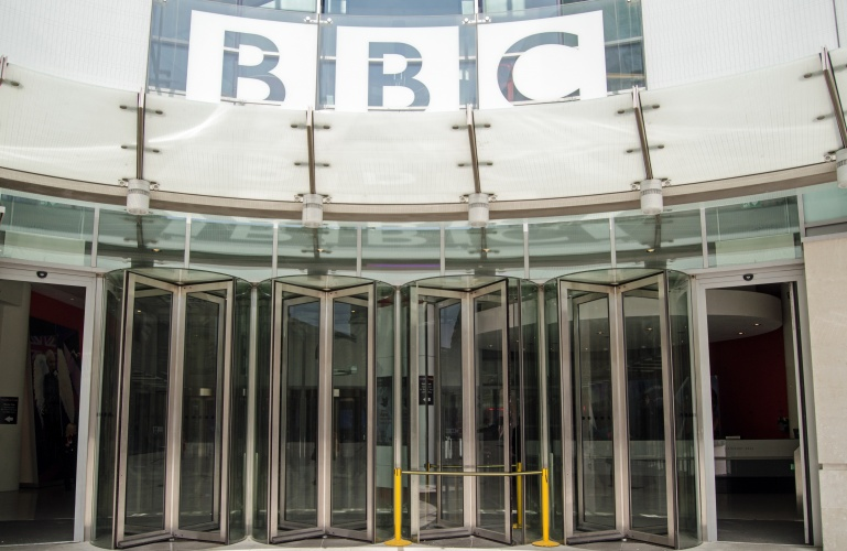 London, England - May 18, 2014: Entrance to the British Broadcasting Corporation's headquarters at New Broadcasting House in London. The building houses journalists and programme makers.