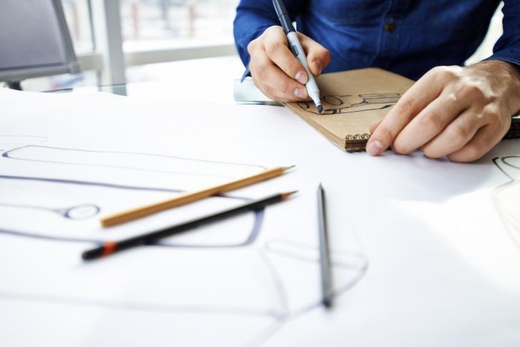 Hands of artist drawing with felt tip pen