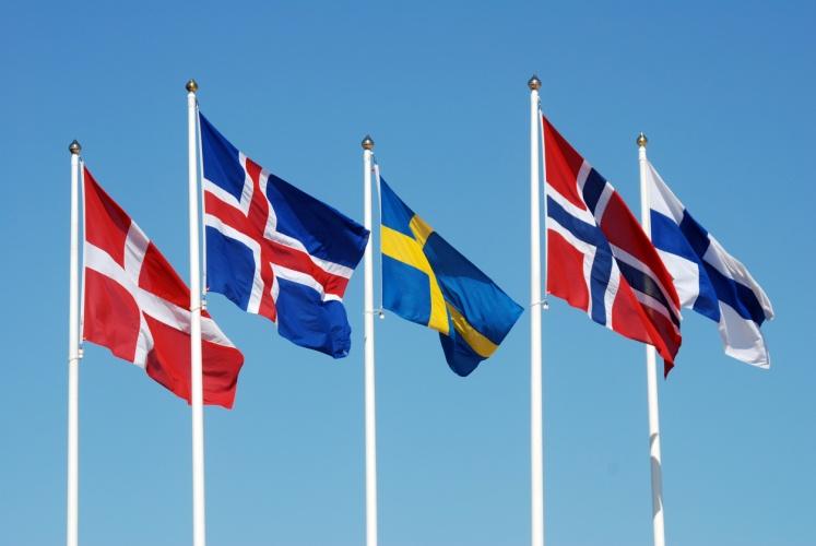 Scandinavian flags on a blue sky.