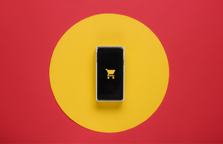mobile phone with shopping cart icon on yellow circle on red background
