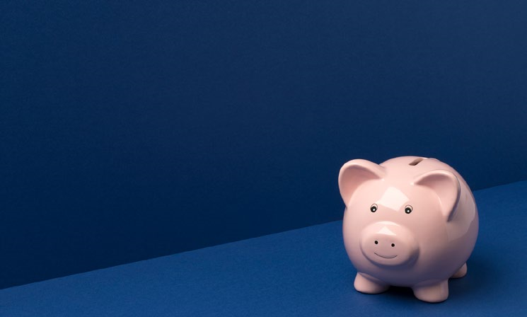 piggy-bank-on-blue-background