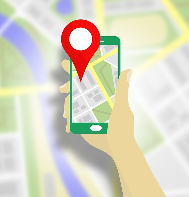 Vector graphic showing a hand holding a mobile phone with a location pin and a map on the screen.