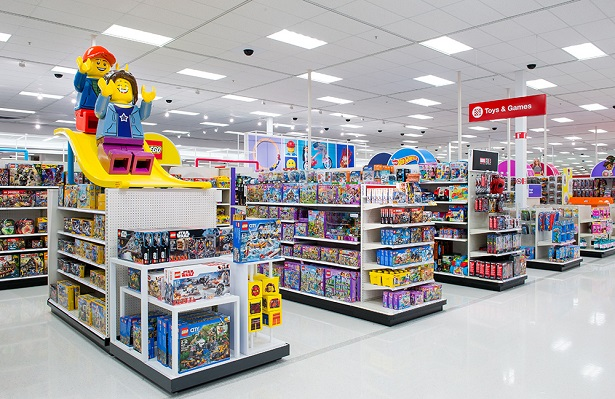 A photograph of Target's reimagined toy store, with two large Lego figures on top of one of the displays.