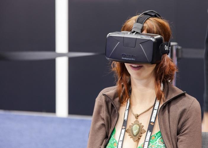 A woman wearing an Oculus Rift headset