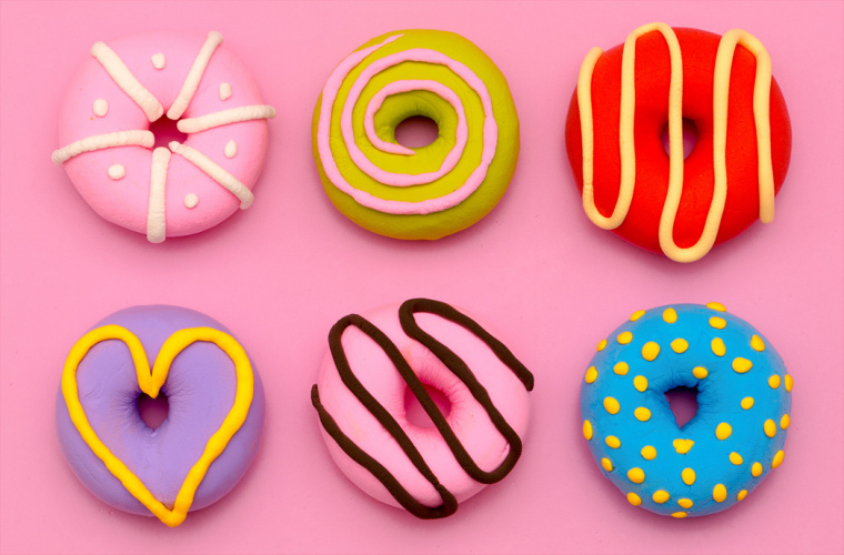 six multicoloured doughnuts