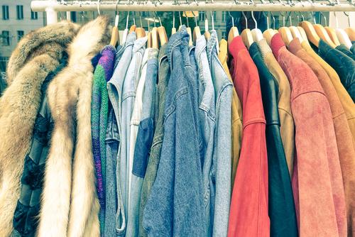 rack of vintage clothes. image via shutterstock
