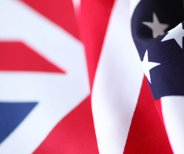 Draped United States flag next to British flag
